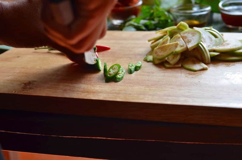slicing chilis for panang curry recipe
