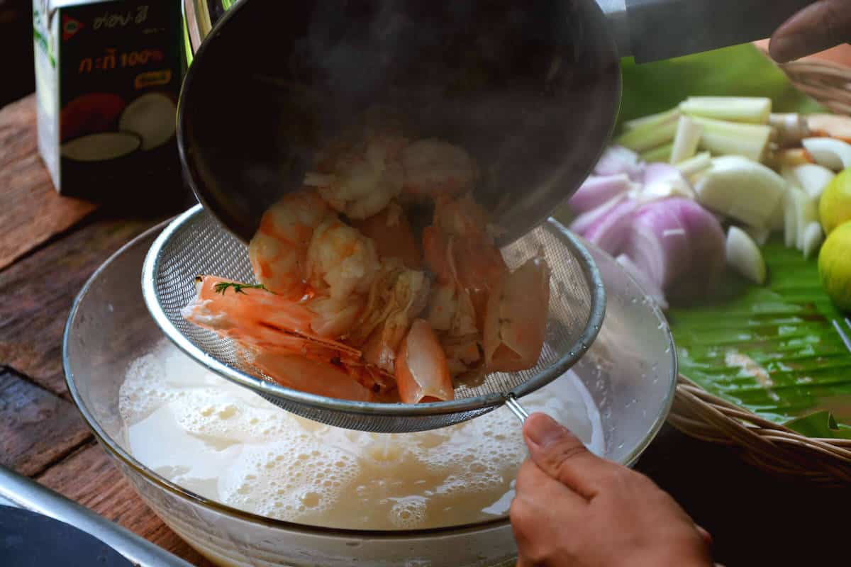 straining tom yum shrimp or prawn
